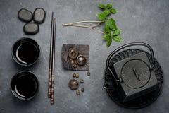 Black iron asian tea set in vintage style. Green tea, pu-erh tea Royalty Free Stock Images