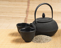 Black iron asian teapot and 2 black iron cups, vintage style. Stock Images