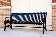 Black Iron Bench on Sidewalk Stock Photography