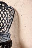Black iron chair wall Royalty Free Stock Photo