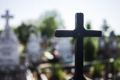 Black iron cross with white cross in background Stock Photos