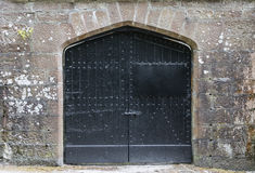 Black iron door in castle. Stock Photos