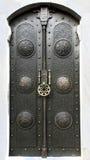 Black Iron Door. Metallic decorated medieval black door Royalty Free Stock Image