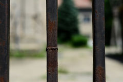 Black iron fence close up. The fence is very old and rusted. Photo was taken about noon, on a nice sunny day in Szeged, Hungary stock images