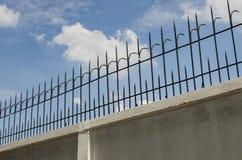 Black iron fence on white wall Stock Photo
