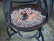 Fire Pit with Burning briquettes Royalty Free Stock Photos