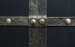 Black iron gate, brass squares and a lock with  latch Royalty Free Stock Photo