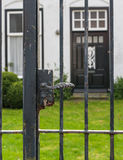 Black iron gate with rusty lock Stock Image