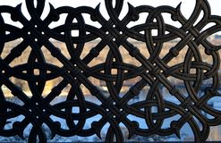 Black iron ornamental texture. Symmetry background. Metal fence. Decorative fence Royalty Free Stock Photos