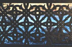 Black iron ornamental texture. Symmetry background. Metal fence. Decorative fence Stock Photo