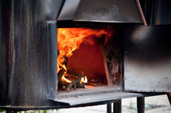 Black iron oven on fire Royalty Free Stock Photos