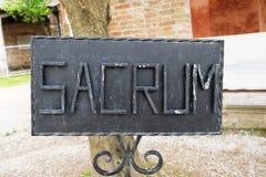 Black iron rectangualar sacrum sign stock photo