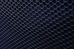 Black iron speaker grid texture. Stock Image
