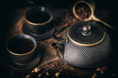 Black iron teapot. With cups of hot tea Stock Photography