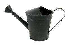Black iron watering can. Isolated on white background stock photo