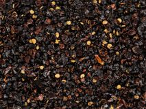 Black Islandic volcano coarse grain salt heap texture. Black Islandic volcano coarse grain salt heap texture with chilli and other spices. Top view royalty free stock photos