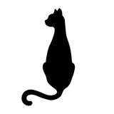 Black isolated silhouette of back sitting cat with turned head on white background. Royalty Free Stock Images