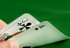 Black Jack. Hand revealing black jack on green felt Royalty Free Stock Photography