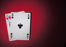 Black jack. Red Jack and a red ace of clubs on the red playing table Royalty Free Stock Images