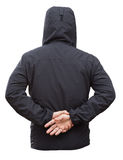 Black jacket with hood and man hands isolated on white backgroun Royalty Free Stock Photos