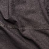 Black jeans cloth material fragment Stock Images