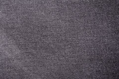 Black jeans material texture background Stock Images