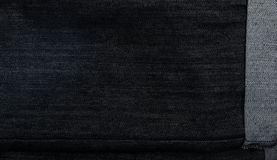 Black jeans texture. Dark cotton fabric background closeup Royalty Free Stock Image