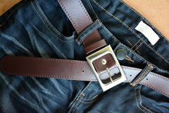 Black jeans trouser and brown leather belt. Royalty Free Stock Photography