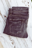 Black jeans on white wood Royalty Free Stock Images