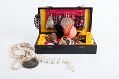 Black jewellery box. Little black box filed with jewellery isolated on white Stock Images