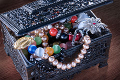 Black jewelry box. A box full of jewelry Royalty Free Stock Images