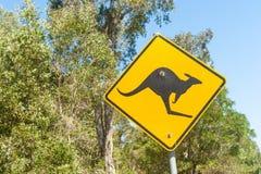 Black kangaroo on yellow reflective  warning sign Stock Photography