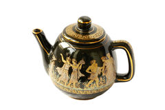 Black kettle for brewing tea with a gold. En pattern Stock Photo
