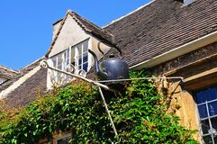 Black kettle on building, Chipping Campden. Royalty Free Stock Photo
