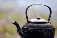 Black Kettle with stream royalty free stock image