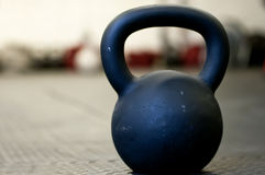 Black Kettlebell on a gym floor Stock Image