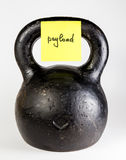 Black kettlebell with label payload Stock Photos