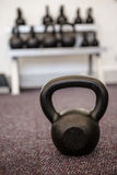 Black kettlebell on the weights room floor Royalty Free Stock Photography