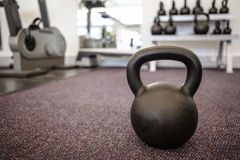 Black kettlebell on the weights room floor Royalty Free Stock Image