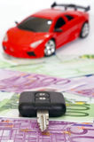 Toy car and keys isolated on white and money backg Stock Photos