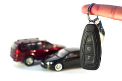 Keys and cars on white background Stock Image