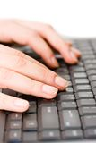 Black keyboard. Fingers on a black keyboard Royalty Free Stock Image