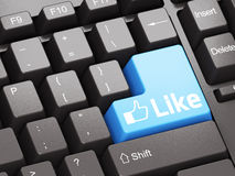 Black keyboard with blue Like button. Social network concept Stock Image