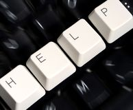 Black Keyboard, blurred, with white keys - HELP Stock Photo