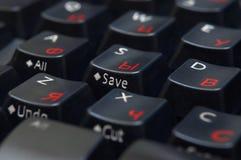 Black keyboard closeup. Black keyboard with red cyrillic letters, closeup, macro Stock Photos