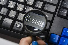 The black keyboard from the computer with a magnifying glass. Keys enter and shift. Tool. Press. Typing. royalty free stock images