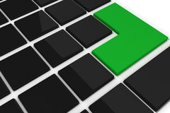 Black keyboard with green key Stock Photos