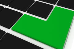 Black keyboard with green key Stock Photo