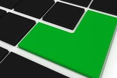 Black keyboard with green key Stock Photo