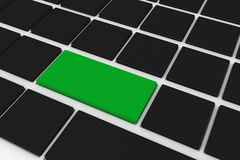 Black keyboard with green key Royalty Free Stock Images